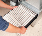 stock-photo-29777520-hands-changing-furnace-air-filter