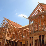 wood-frame-house-under-construction-full-width-place